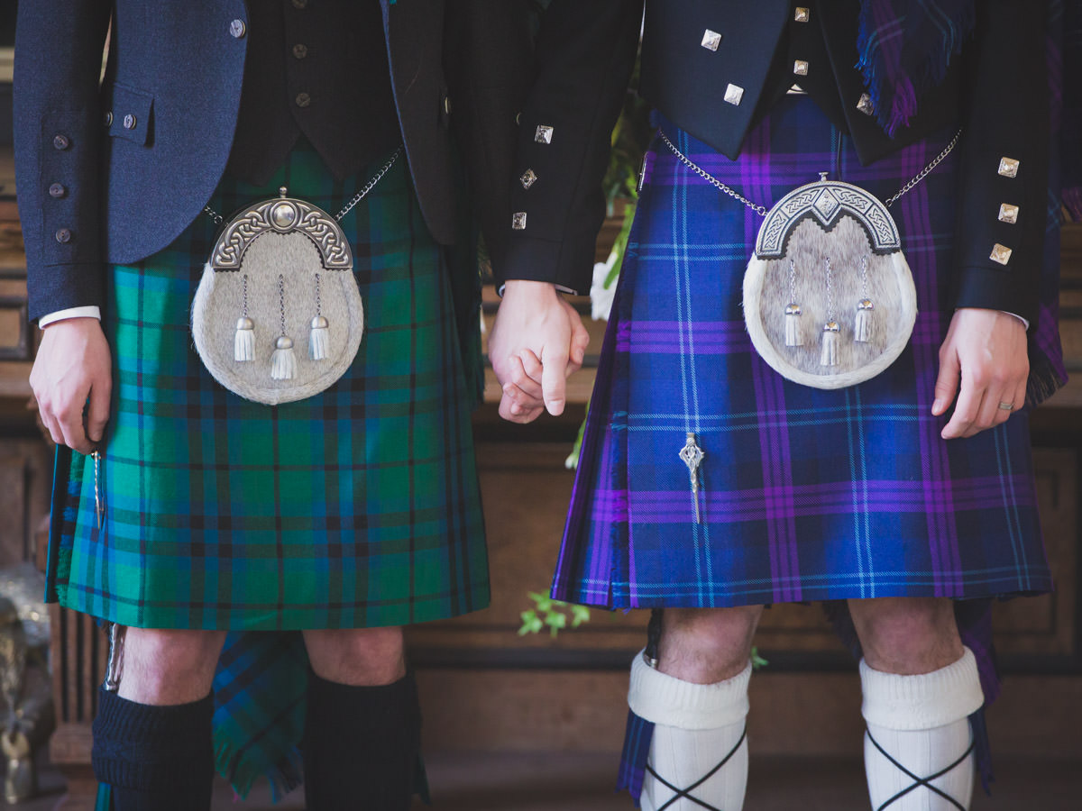 Wedding at Springkell House. Gay wedding two grooms in kilts holding hands.