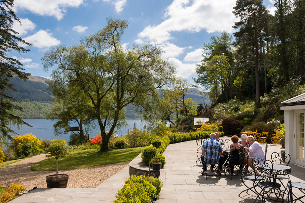 Lodge on Loch Goil Wedding. Pre wedding ceremony drinks on the patio.