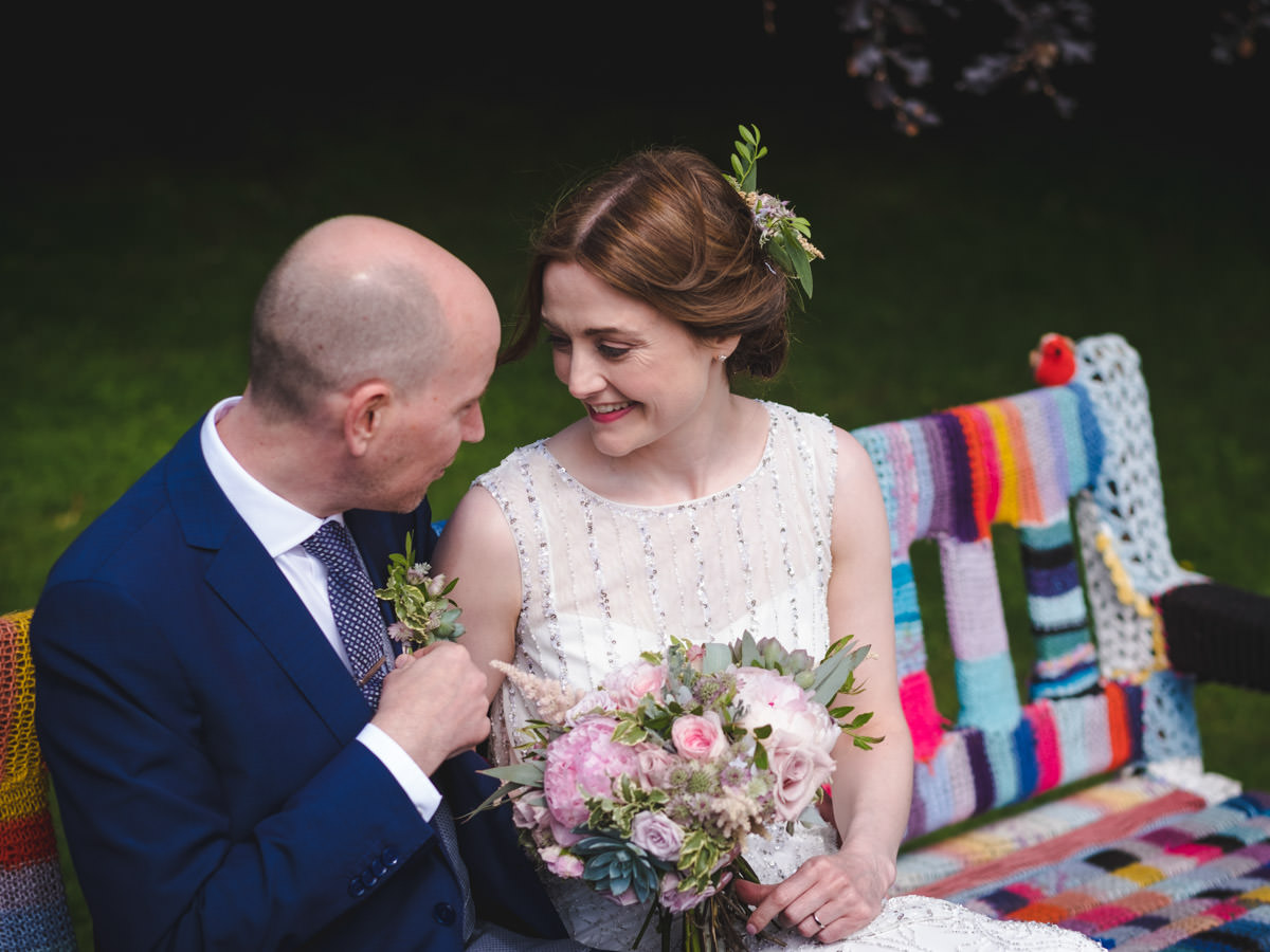 Glasgow Botanic Gardens Wedding. Bride and Groom sat on bench.