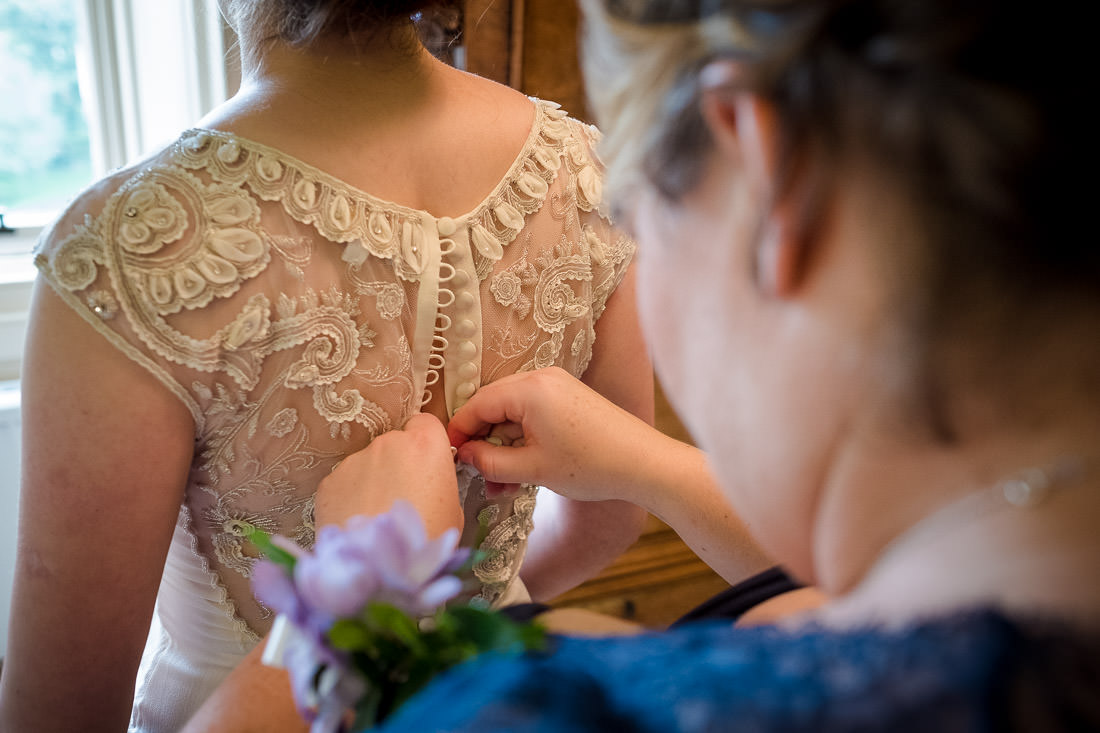 Culzean Castle Wedding Temperley Wedding Dress getting buttoned up