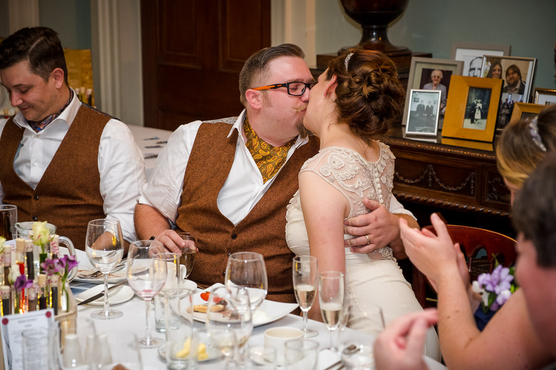 Culzean Castle Wedding Bride and Groom Kissing at Table