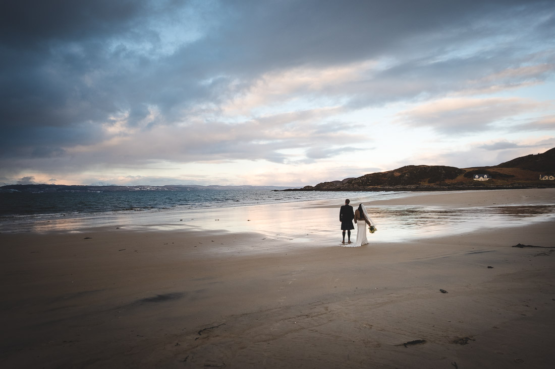 Winter Elopement in Arisaig - bride and groom wedding photographs Morar beach Camusdarach