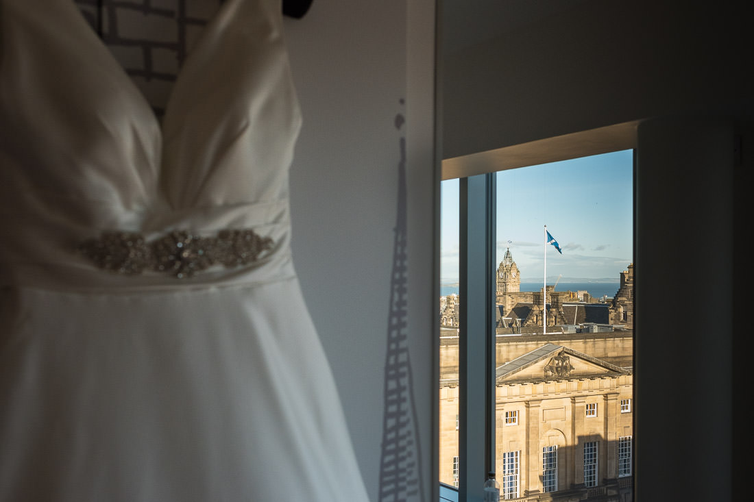 Signet Library Wedding in Edinburgh - wedding dress hanging with a view of Edinburgh