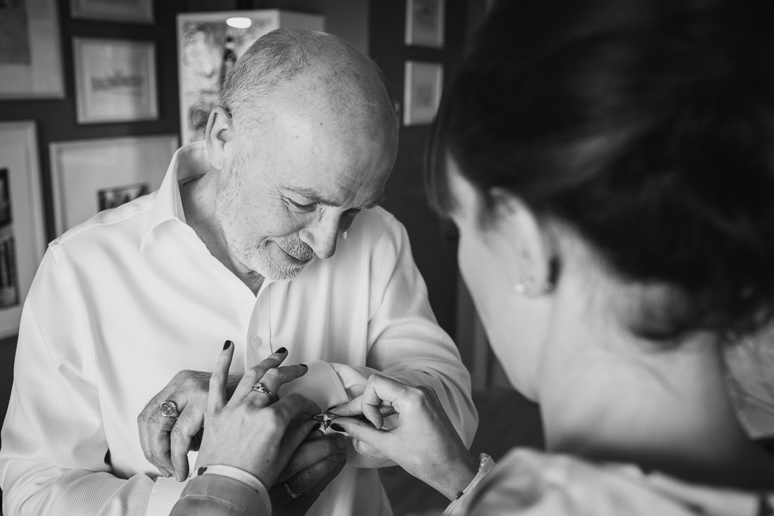 Signet Library Wedding in Edinburgh - bride helping her father with his cufflinks