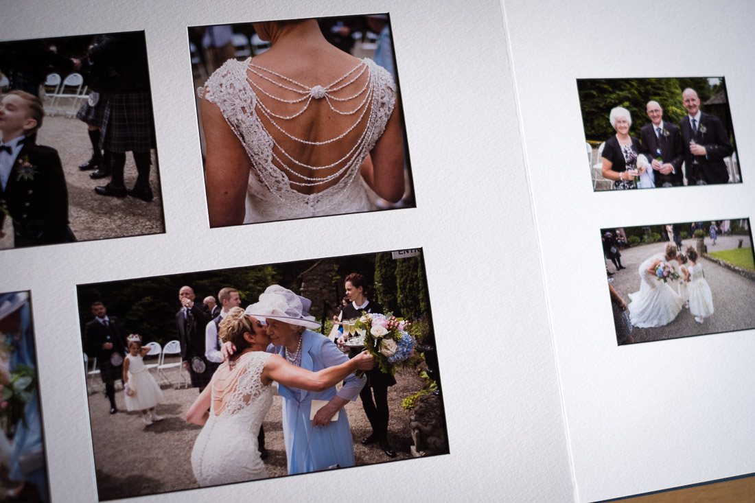 Inside view of a typical page layout in a Graphistudio Matted style album with white mounts and a black core.