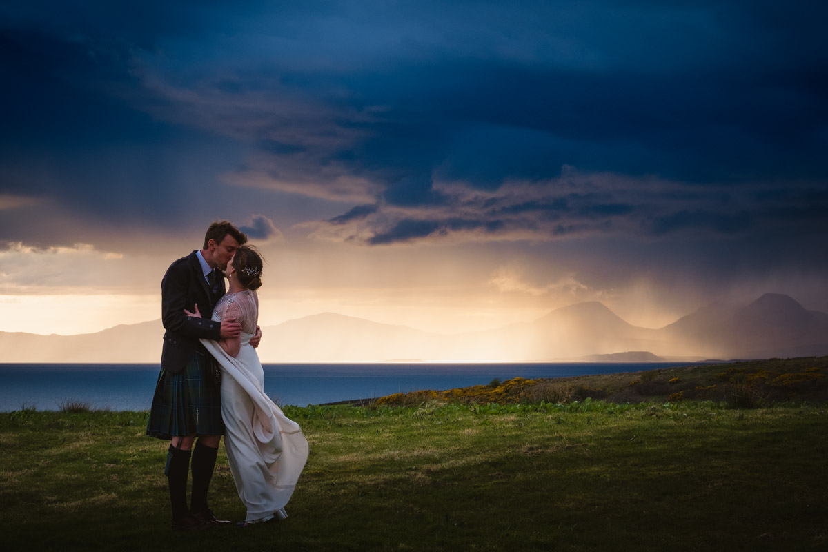 Crear Wedding Bride and Groom cuddling with the sunset of Jura and Islay in the background