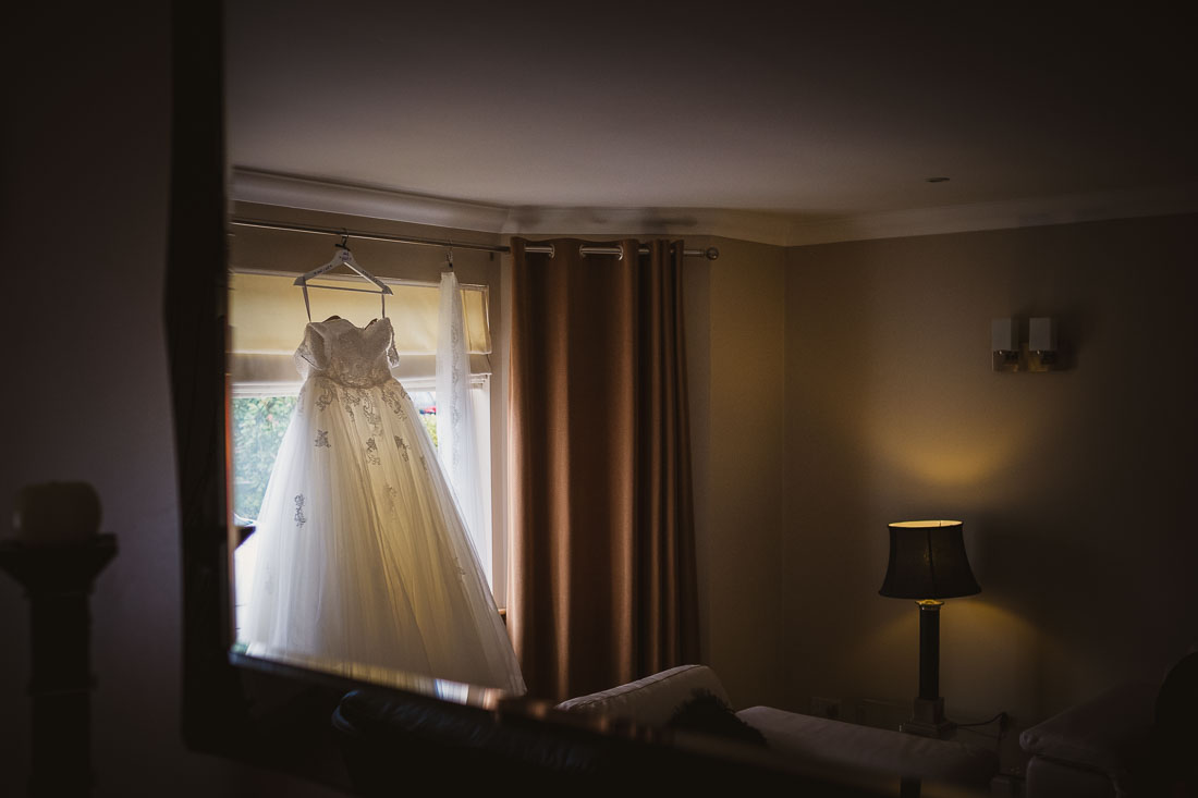 Wedding dress hanging by the door