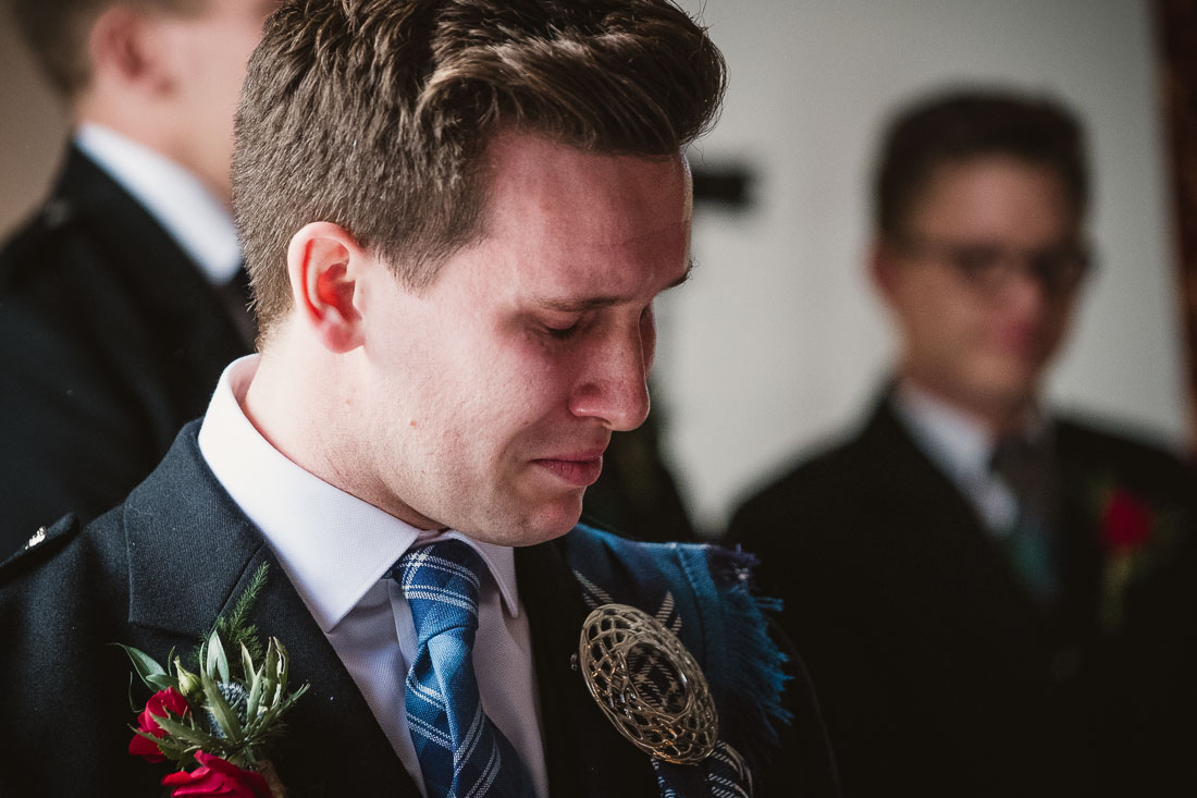 Emotional groom waiting for the bride to arrive